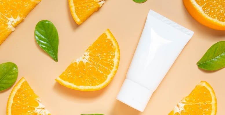 Haarwuchsmittel Orangenscheibe und Ein Tube Creme